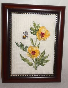 Very beautiful picture of yellow buttercup flowers framed in a cherry wood colored frame. Theme: Buttercup flowers with Bee. Style: Cross Stitch. Item: Framed Picture. Frame: Cherry wood look. | eBay!