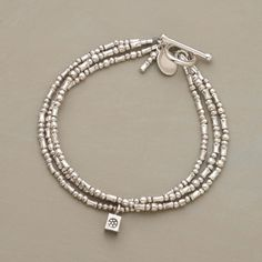 """STERLING TRIPLETS BRACELET--Three identical strands of sterling beads jingle charmingly on the wrist. One dangles a flower-stamped cube. Toggle clasp. Handmade in USA exclusively for us. 7-1/2""""L."""