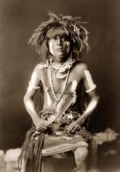 Photo of Honovi-Walpi, a Hopi Snake Priest, with Totkya.  It was made in 1910 by Edward S. Curtis.