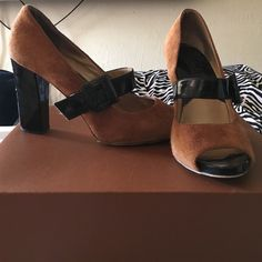 Black and brown suede Michael Kors pumps Super cute black and brown suede pumps with a buckle. Chunky Mary Jane heel, open toe. Very minor signs of wear, please see all photos. Bottom soles show scuffs. Genuine suede and patent leather. 100% authentic. MICHAEL Michael Kors Shoes Heels