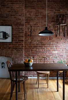 I am in love with brick walls inside the house... however not so okay with the floating chair on the wall...??