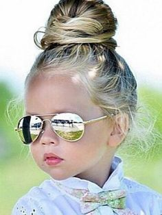 Adorable little girl with aviator sunglasses