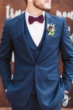 Groom wears Navy Blue Suit with burgundy bow tie #burgundy #groomstyle #wedding #navyblueburgundy