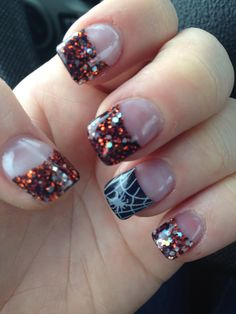 Early Halloween nails! Black and orange sparkle tips and spider web accent nail