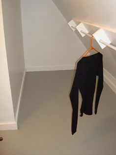 For coat closet....could store coats we don't use as much behind the ones we do....  Here's an idea for dealing with sloped ceilings.