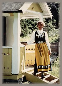 A Swedish front Porch and the national folk costume. I love the porch rails.