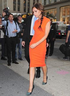 VB in an orange dress of her own design.
