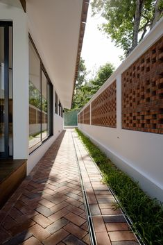Image 9 of 32 from gallery of Pitch House / Atelier M+A. Photograph by Masaki Harimoto Brick Design, Fence Design, Facade Design, Home Room Design, House Design, Compound Wall Design, Boundary Walls, Kerala Houses, Wall Exterior
