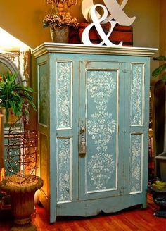Debbie Dion Hayes of Annie Sloan Unfolded painted and stenciled this beautiful armoire with Duck Egg Blue Chalk Paint™️ decorative paint and both our Fabric Damask and Brocade Border stencils in Old White. (And a really big tassel.) #paintedfurniturefabric