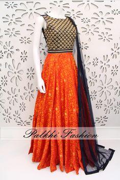 PalkhiFashion Exclusive Full Flair Light Orange/ Navy Blue Silk Gown with Elegant Work.
