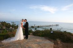 Bride on the beach wearing Save the Veil