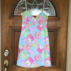 "CLASSY LILLY PULITZER DRESS Lilly Pulitzer butterfly pattern dress. Primary colors pink; blue and purple. Zipper back. 34.5"" length. 29"" empire waist. Adjustable spaghetti straps. 32"" armpit to armpit. Lilly Pulitzer Dresses Midi"