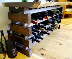 Last week we've showed you a wine rack made from pallets (see http://on.fb.me/154Ytsb ), but, as you pointed out, wine should be stored on its side. So here's a pallet wine rack/table with you in mind :) Does this suit your taste? Let us know in the comments section!