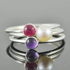 A personal favourite from my Etsy shop https://www.etsy.com/hk-en/listing/150784785/white-pearl-ring-gemstone-ring-stacking