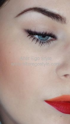 Two tone lips, orange and red, matte and long lasting, defined brows and flawless skin.