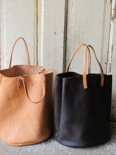 Inspired by the French countryside and the common name given to cows Marguerite, this is a very soft oil tanned bucket bag, in rich chocolate color. This is a very durable leather, reHandbags & Wallets - dark brown tote made in USA - How should we c Prada Handbags, Tote Handbags, Purses And Handbags, Leather Handbags, Luxury Handbags, Cheap Handbags, Cheap Purses, Leather Tote Bags, Popular Handbags