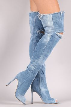 These stunning over-the-knee boots feature a peep toe silhouette, distressed denim shaft with a fringed opening and a stringy destroyed patch at the knee. Finished with a cushioned insole, soft lining