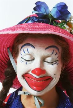 Female clown smiling with eyes closed, portrait, close-up