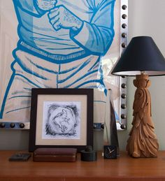 Hayes displays a wide range of cherished antiques: a vintage police target he found in Los Angeles, a sketch by the artist Gillian Jagger, injection molds, his grandfather's tie-clip box, and another pair of lamps from Ron Sharkey, made from old chair legs.