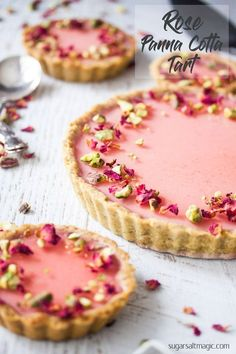 Pistachio Rose Panna Cotta Tart, with it's pistachio tart crust, rose panna cotta filling and rose jelly topping is a beautiful tart just perfect for a special occasion. via Sugar Salt Magic tarte Fancy Desserts, Just Desserts, Delicious Desserts, Yummy Food, Gourmet Desserts, Gourmet Foods, Healthy Food, Tart Recipes, Sweet Recipes