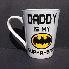 A personal favorite from my Etsy shop https://www.etsy.com/listing/233459522/daddy-is-my-superhero-mug-batman-coffee