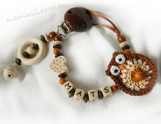 Pacifier chain clip Dummy holder, keeper personalized with name, owl, heart, bell and wooden beads, brown & beige (item 14193). $18.90, via Etsy.