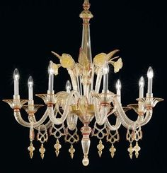 Il Mondo della Luna. A wonderfully elegant 8 light chandelier from De Majo, created by the maestro Vittorio Polesel, and measuring 120 cm in height. This is a rather glamorous chandelier, keeping to the Venetian tradition without being overly ornate. The Murano glass elements which make up this sublime chandelier are coloured gold and red. http://www.italian-lighting-centre.co.uk/modern-murano-glass/mondo-della-luna-chandelier-from-majo-p-8252.html