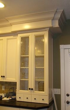Get rid of the old scalloped stuff on the cabinets and add some nice thick crown molding! Plus I like the unit.