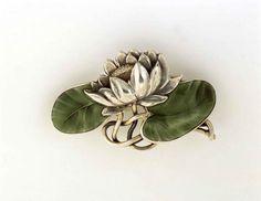 Water Lily ..for Peace & Purity  Georg Adam Scheid Jugendstil brooch: silver, enamel. Austrian, circa 1900. Image: Design Gallery