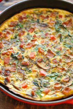 Mushroom Spinach Frittata - So quick, so easy and so perfect as a quick weeknight dinner or fancy brunch - and you can make it ahead of time too! Use coconut milk and nitrate-free turkey bacon for Phase 3 (serves 6); vegetarians, just omit the bacon (serves 5). For H-Burn, omit the bacon and sub another veggie for the tomato (asparagus would be great) to serve 5.