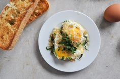 fontina & spinach baked eggs with garlic brown butter breadcrumbs