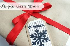 Handmade Sharpie Bookpage Gift Tags by Design, Dining + Diapers #sharpie #christmas #holiday