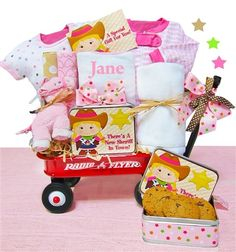 d83aa9a5c248 This cute wagon comes filled with three blankets for baby and cookies for  Mom and Dad