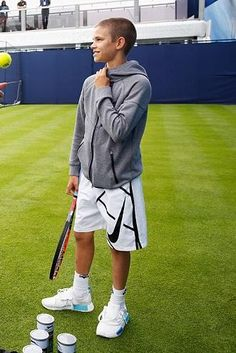 Romeo Beckham wearing Adidas Nmd Runner in White/Blue Glow Mesh, Nike Tech Fleece Windrunner Full-Zip Boys Jacket and Nike Court 9 Graphic Tennis Shorts