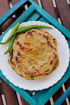 Easy Lauki Paratha recipe - made with fresh bottle-gourd (lauki), spices and whole wheat flour. This is simple yet healthy, flavorful also an ideal snack for lunch box or breakfast. Puri Recipes, Paratha Recipes, Veg Recipes, Indian Food Recipes, Vegetarian Recipes, Cooking Recipes, Indian Breakfast, Breakfast Time, Breakfast Recipes