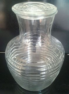 Vintage glass pitcher (horizontal rib Manhattan line) from Anchor Hocking.  My grandmother always kept ice cold water from her refrigerator in this pitcher.