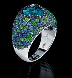 Mousson Atelier Riviera Ring made of Gold 750 features Topaz 3.46ct with 2.36ct Sapphire and 1.40ct Tsavorite; 7.99g total weight