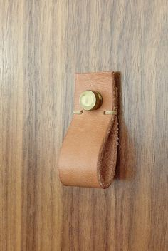 Swap out the given drawer pulls for these cool leather pull on your sink vanity. You could buy these or I also have a tutorial of making your own out of real leather.