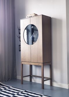 The timeless IKEA STOCKHOLM glass door cabinet has adjustable shelves, integrated dampers for silent, soft closing and a cord outlet in the back. Perfection!