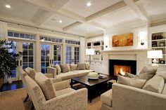 Suzie: Paul Moon Design - Gorgeous living room design with coffered ceiling, wall of French ...