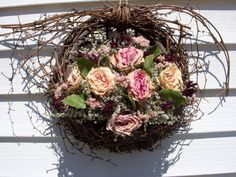Victorian vine wall basket is filled with dried roses, herbs, and flowers