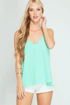 This mint chiffon tank has us craving Summer time fun! We love the back detail and it pairs perfectly with our Blush Racerback Bralette.