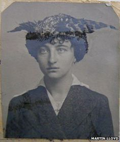 French woman with a pheasant-style hat  passport foto, this is so hilarious to me, idk why