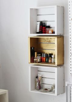A row of crates are more customizable than a static bathroom shelf.