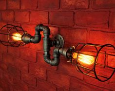 Pipe Lighting w/ Cages, S bend Wall Art, Steampunk & Industrial, bathroom vanity light - Wall sconce light fixture, black pipe light Pipe Lighting, Wall Sconce Lighting, Wall Sconces, Vanity Lighting, Loft Lighting, Lighting Ideas, Industrial Wall Lights, Industrial Bathroom, Industrial Pipe