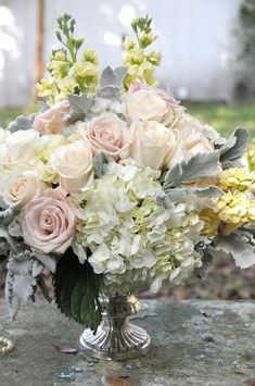 Blush and gray centerpiece-with hints of lavender shade reception wedding flowers,  wedding decor, wedding flower centerpiece, wedding flower arrangement, add pic source on comment and we will update it. www.myfloweraffair.com can create this beautiful wedding flower look.