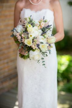 Ivory tulips and soft blush and lavender accents: http://www.stylemepretty.com/little-black-book-blog/2015/01/23/elegant-garden-themed-wilmington-wedding/ | Photography: Theo Milo - http://theomilophotography.com/