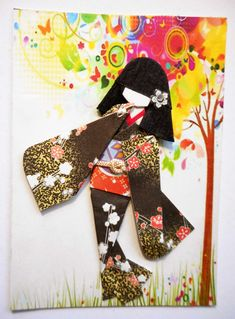 https://flic.kr/p/yL1kCD | ATC1281 - Happy with the world | ATC with hand-folded Japanese origami paper doll. Traded at AFA.  Materials: Background pattern print from 123RF; kimono and obi (origami washi); viscose cord on obi; hair decor (nail art sticker).