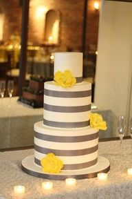 Keep yellow flowers but amber color and maybe have one teal ribbon with the rest burnt orange