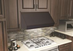 ZLINE 30 in. 1200 CFM Designer Series Under Cabinet Range Hood (8685B-30) has a modern design and built-to-last quality that would make it a great addition to any home or kitchen remodel. This hood's high-performance 4-speed motor will provide all the power you need to quietly and efficiently ventilate your kitchen.